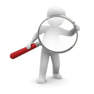 Cartoon character holding a magnifying glass and peering through it