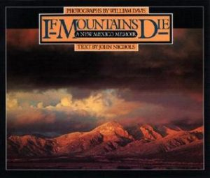 If Mountains Die- A New Mexico Memoir by John Nichols book cover. Image on cover shows stormy clouds passing over mountains bathed in red evening light.
