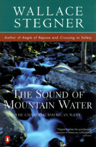 The Sound of Mountain Water by Wallace Stegner book cover. Image on cover is of a mountain stream filled with water rushing over the many rocks in it.