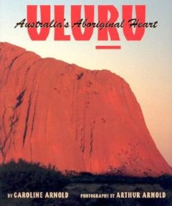 Uluru- Australia's Aboriginal Heart by Caroline Arnold book cover. Image on cover shows Mount Uluru in all of it's red, dusty glory.