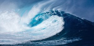 An ocean wave curling in on itself