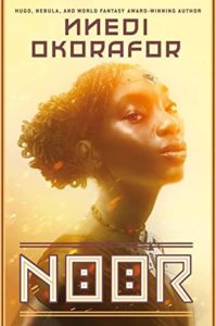 NoorbyNnedi Okoraforbook cover. Image on cover shows african woman holding her head up high.