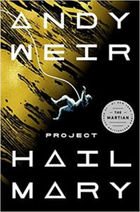 Project Hail Mary by Andy Weir book cover. Image on cover shows an astronaut floating through space while tethered to their ship. There is a large sun or planet in the background.