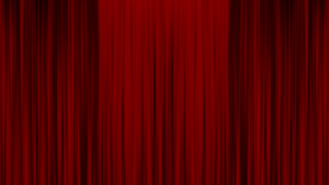 Red, closed cinema curtains.
