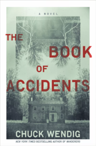 The Book of Accidents by Chuck Wendigbook cover. Image on cover is a black-and-white-photograph of a ghost standing in front of an old and possibly abandoned house in the woods.
