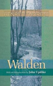 Walden by Henry David Thoreau book cover. Image on cover is a black-and-white photo of a stream flowing thorugh a forest.