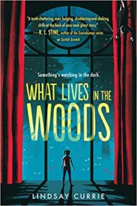 What Lives in the Woods by Lindsay Currie book cover. Image on cover is a painting of a kid standing in front of a two-story picture window at night. There are yelllow-eyed creatures standing outside leering at her.