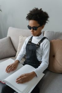 Blind child reading a braille book